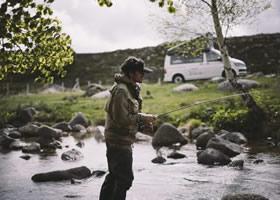 Man fishing near his camper van
