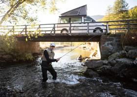 Man during his camper van fishing trip